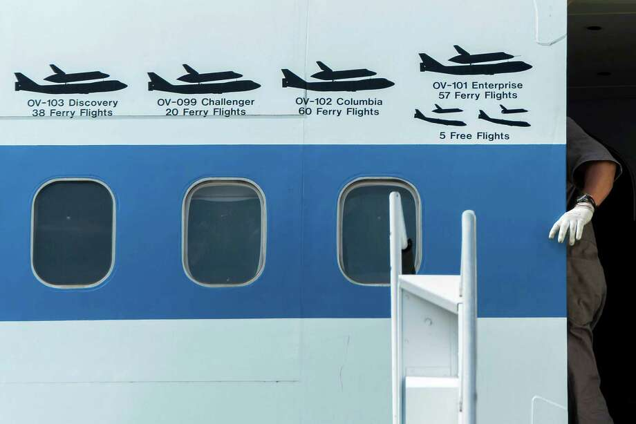 Logos on the fuselage mark all of the flights of the NASA Shuttle Carrier Aircraft.  Photo: Smiley N. Pool, Houston Chronicle / © 2014  Houston Chronicle