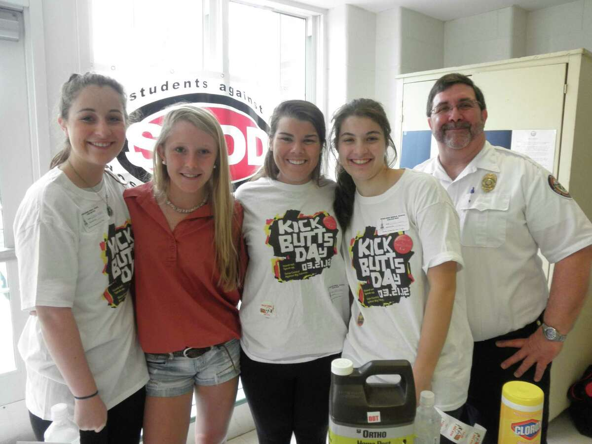 """YWCA Parent Awareness and Students Against Destructive Decisions are hosting a film and panel discussion, """"Students Tell All: What Parents Really Need to Know"""" Wednesday, April 2, at the Darien Town Hall auditorium. From left, SADD members Colleen Heaney, Haley Close, Sloane Clarke and Caroline Feehan with Fire Marshal Bob Buch at """"Kick Butts Day"""" at Middlesex Middle School, one of the many national events in which the Darien chapter of SADD participates."""