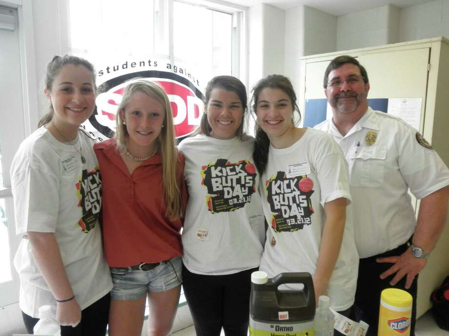 "YWCA Parent Awareness and Students Against Destructive Decisions are hosting a film and panel discussion, ""Students Tell All: What Parents Really Need to Know"" Wednesday, April 2, at the Darien Town Hall auditorium. From left, SADD members Colleen Heaney, Haley Close, Sloane Clarke and Caroline Feehan with Fire Marshal Bob Buch at ""Kick Butts Day"" at Middlesex Middle School, one of the many national events in which the Darien chapter of SADD participates. Photo: Contributed Photo, Contributed / Darien News"