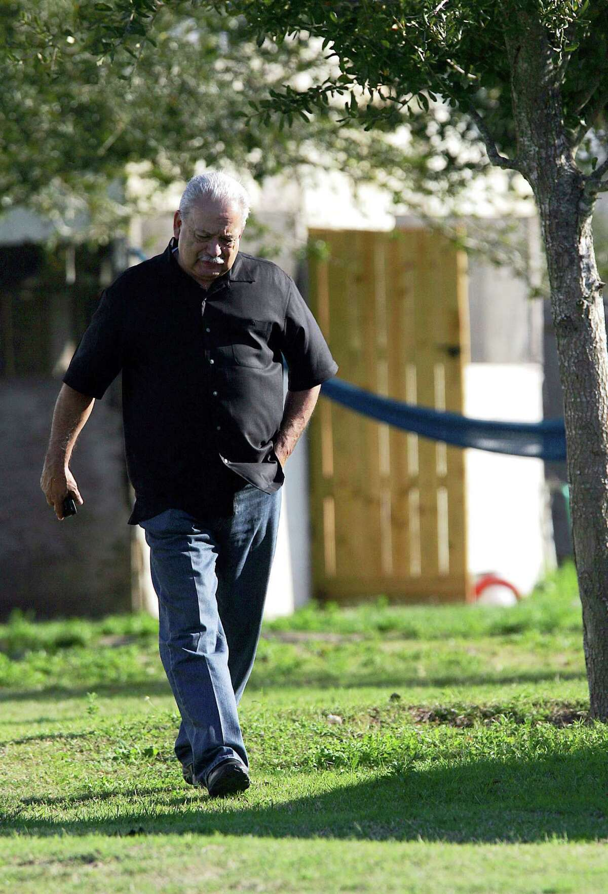 In this photo taken on Feb. 19, 2014, Hidalgo County Sheriff Lupe Trevino walks around a home that was raided north of Monte Cristo in Edinburg, Texas, as they searched for Jose Juan Mendoza after he kidnapped Juan Pedro Borjas. The Hidalgo County Sheriff office has announced Wednesday, March 26, 2014, that the Trevino's chief of staff has resigned for personal reasons, the latest high-level personnel change at an agency that has drawn the attention of federal investigators. (AP Photo/The Monitor, Gabe Hernandez) MAGS OUT; TV OUT