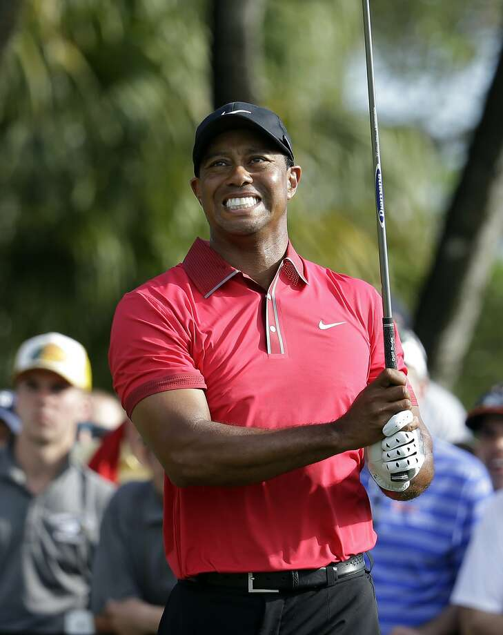 Tiger Woods watches his drive at Doral, Fla., during a final- round 78 that landed him in 25th, his best finish this season. Photo: Lynne Sladky, Associated Press