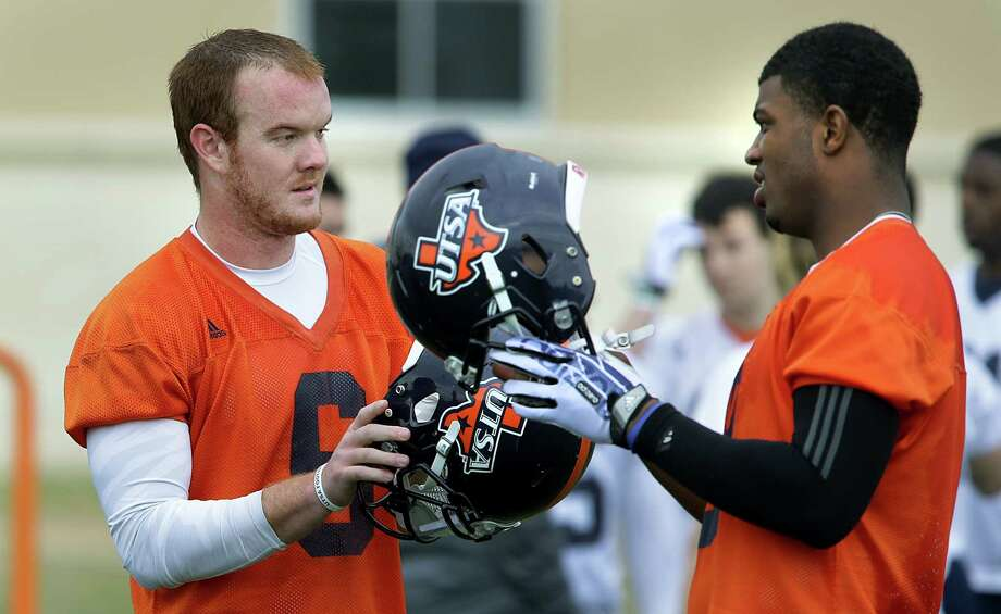 UTSA quarterbacks Tucker Carter, left, and Austin Robinson, chat during a recent football practice, Wednesday, March 26, 2014. Photo: BOB OWEN, San Antonio Express-News / © 2012 San Antonio Express-News