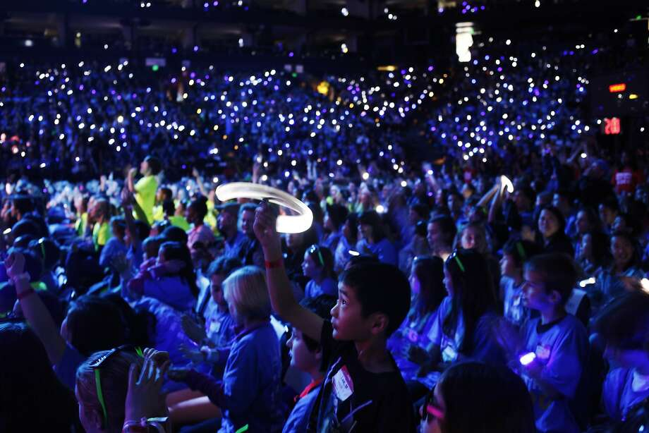 Matthew Lee, a fourth grader at Ohlone Elementary in Palo Alto, waves a light that was given to all audience members during We Day California at Oracle Arena on March 26, 2014 in Oakland, Calif. We Day is an initiative of Free The Children, an international philanthropic organization, that brings together 16,000 students and teachers from 400 schools across the state. Photo: Pete Kiehart, The Chronicle