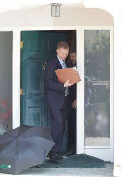 Investigators exit the house of state Sen. Leland Yee (D-8th Dist.) in San Francisco on Wednesday, March 26, 2014. Photo: Mathew Sumner, Special To The Chronicle