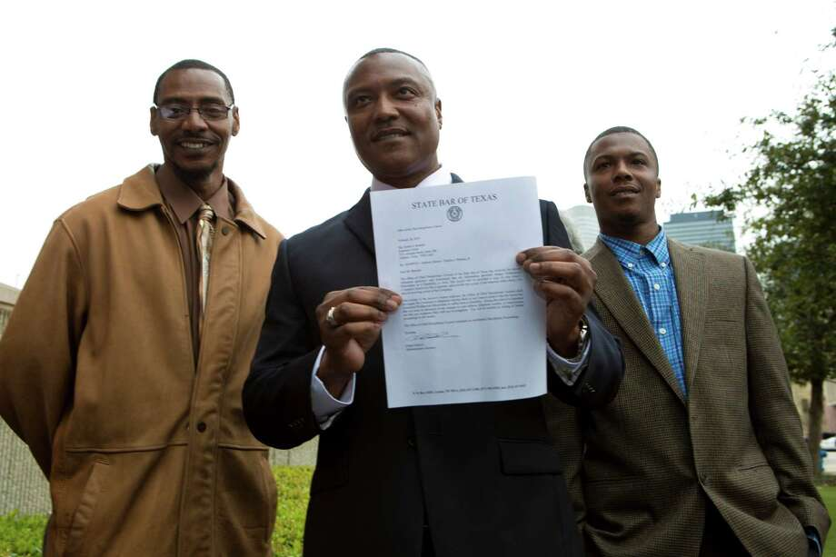 Exonerated Texas death row inmate Anthony Graves, center, accompanied by his son Terrance Williams, right, 30, and Graves' brother Derrick Curry, 45, left, holds a letter by the State Bar of Texas Office of the Chief Disciplinary Counsel, Wednesday, March 5, 2014, in Houston. Graves explained the emotional damage his family suffered by the 18 years he was incarcerated. ( Marie D. De Jeséºs / Houston Chronicle ) Photo: Marie D. De Jeséºs, Staff / © 2014 Houston Chronicle