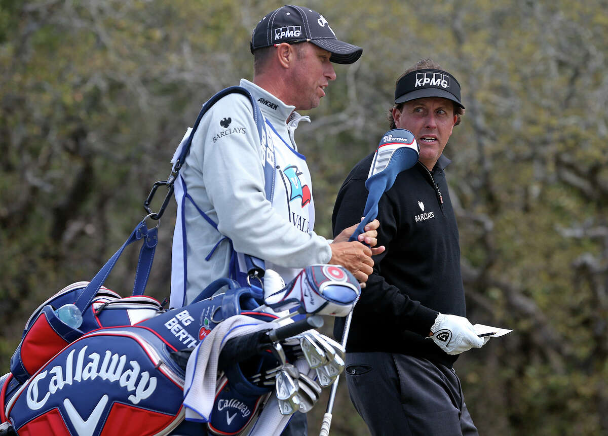 Phil Mickelson heads out off the number 1 tee box after during the Zachry/JV Industrial Pro-Am on March 26, 2014.