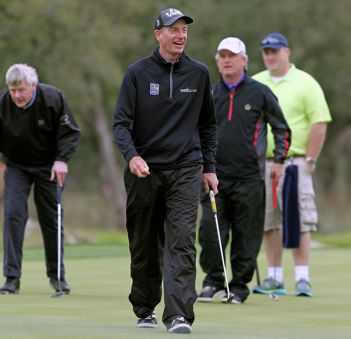 Jim Furyk laughs with his playing partners during the Zachry/JV Industrial Pro-Am on March 26, 2014.