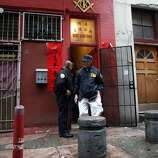 SFPD and FBI agents stand outside the Ghee Kung Tong Chinese Free Masons Temple in Chinatown that was the target of a raid related to Sen. Leland Yee's arrest, San Francisco, CA, Wednesday Mar. 26, 2014.The FBI raids State Sen. Leland Yee's office in Sacramento and other locations were searched by the FBI in San Francisco. He was reportedly arrested on public corruption charges Wednesday morning amid raids of his office in Sacramento and searches by the FBI in San Francisco.