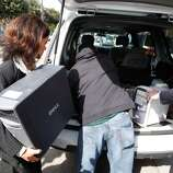 FBI investigators load computers and other evidence from the house of state Sen. Leland Yee (D-San Francisco) in San Francisco on Wednesday, March 26, 2014. Yee has been arraigned in federal court on charges of public corruption.