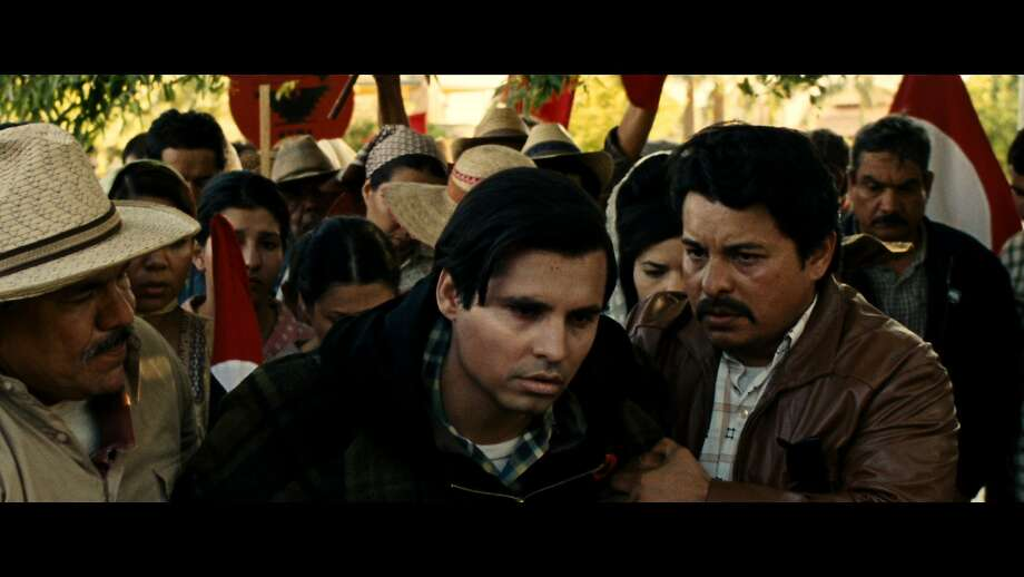 Michael Peña (left) stars as Cesar Chavez, behaving as a man who carries the compassion that comes from loss, but also an edge of cynicism. Photo: Lionsgate