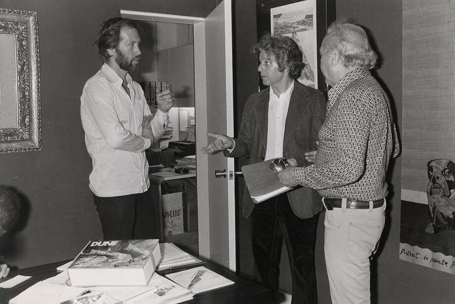 "David Carradine (left) and Alejandro Jodorowsky (center) discuss the plans to make a film of ""Dune."" Photo: Courtesy Of Sony Pictures Classi"