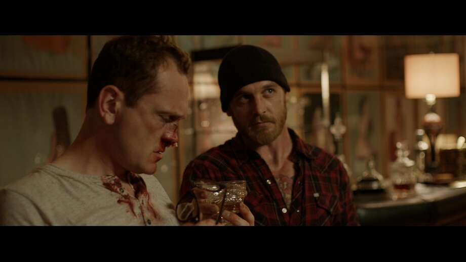 "Craig (Pat Healy) and Vince (Ethan Embry) get in over their heads in the extravagantly gruesome - though skillfully made - ""Cheap Thrills."" Photo: Drafthouse Films"