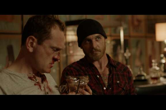 Craig (Pat Healy) and Vince (Ethan Embry) in over their heads in Drafthouse FilmsÕ Cheap Thrills.