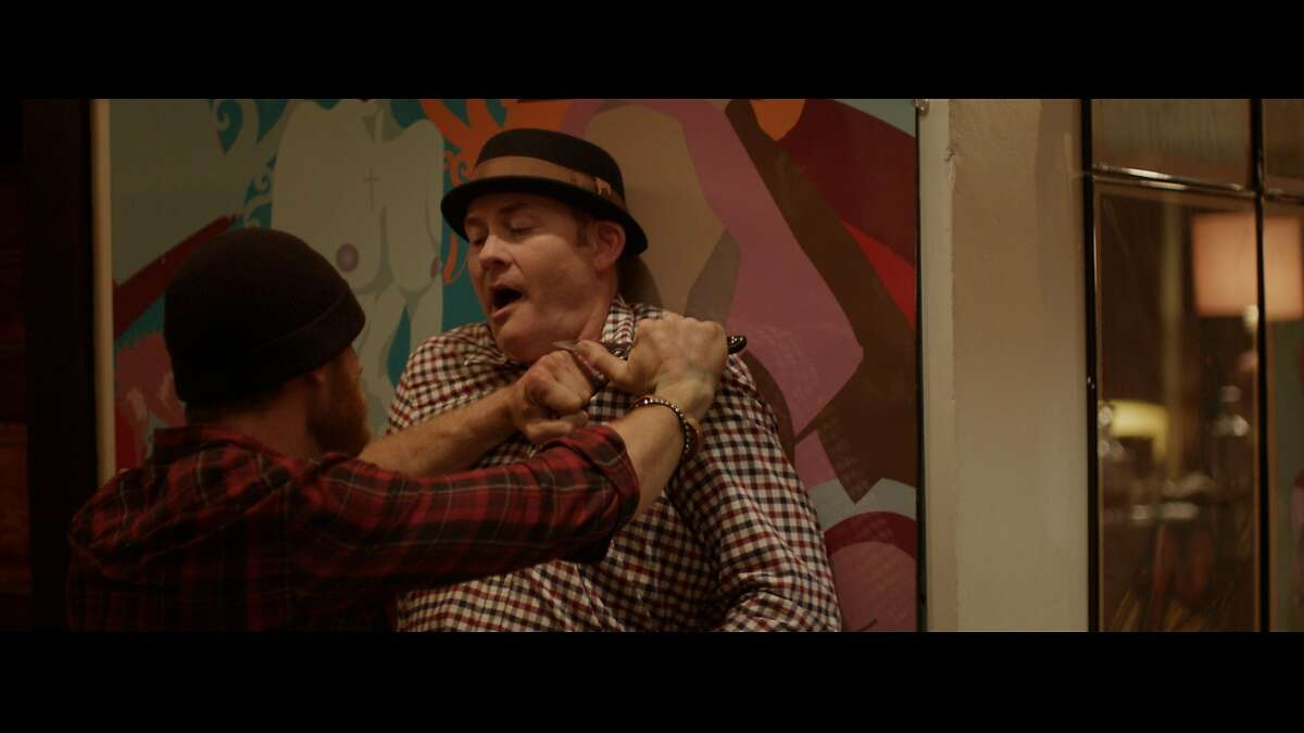 Vince (Ethan Embry) and Colin (David Koechner) in a heated moment in Drafthouse Films?• Cheap Thrills.