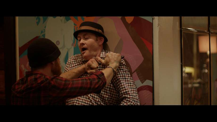 "Vince (Ethan Embry, left) and Colin (David Koechner) in a heated moment in ""Cheap Thrills."" Photo: Drafthouse Films"