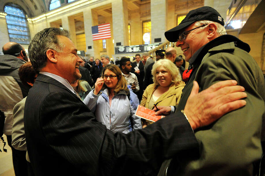 Metro-North Railroad President Joseph Giulietti, left, speaks with Rowan Snyder, of Greenwich, during his first public listening session with commuters at Grand Central Terminal in New York, NY, on Wednesday, March 26, 2014. Snyder got Giulietti to sign a schedule to give to his kids. Photo: Jason Rearick / Stamford Advocate