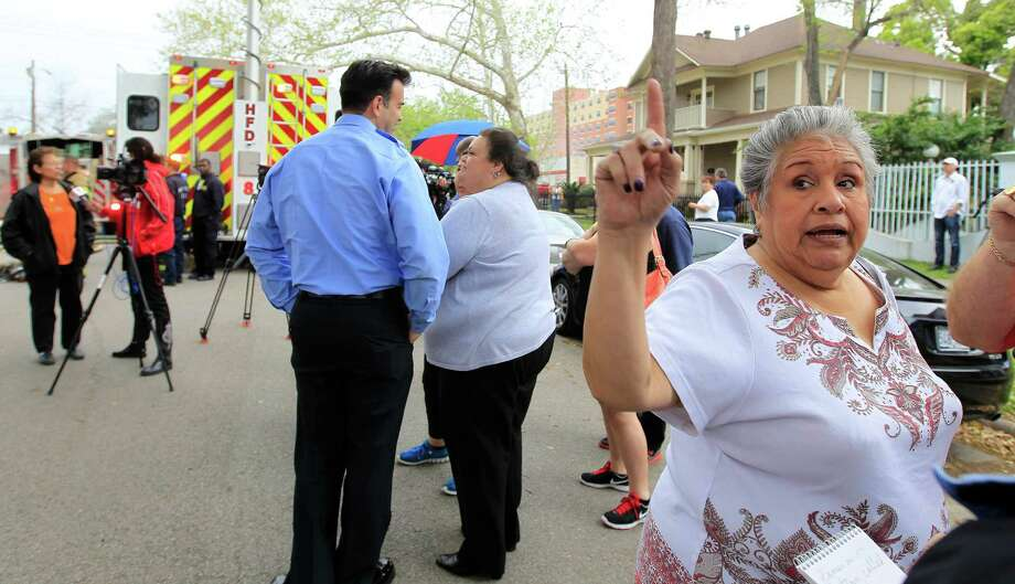 Alice Grabel, a volunteer church secretary at the Heights Presbyterian Church, tells reporters that she called the police to report a suspicious person just before fire broke out at the church located at 240 W 18th Street, Wednesday, March 26, 2014, in Houston. No injuries were reported. The church building is 111-years-old and was home to a small congregation. Photo: Karen Warren, Houston Chronicle / © 2014 Houston Chronicle