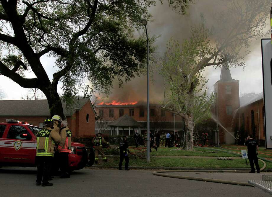 Houston Firefighters work to contain a two-alarm fire at the Heights Presbyterian Church at 240 W 18th Street, Wednesday, March 26, 2014, in Houston. No injuries were reported. The church building is 111-years-old and is home to a small congregation. Photo: Karen Warren, Houston Chronicle / © 2014 Houston Chronicle