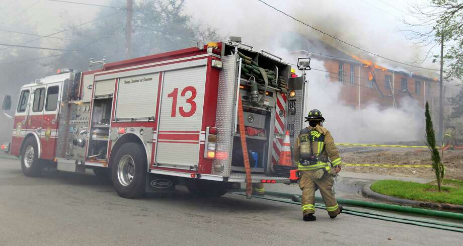 Houston Firefighters work to contain a two-alarm fire on the backside of the Heights Presbyterian Church at 240 W 18th Street, Wednesday, March 26, 2014, in Houston. Photo: Karen Warren, Houston Chronicle / © 2014 Houston Chronicle