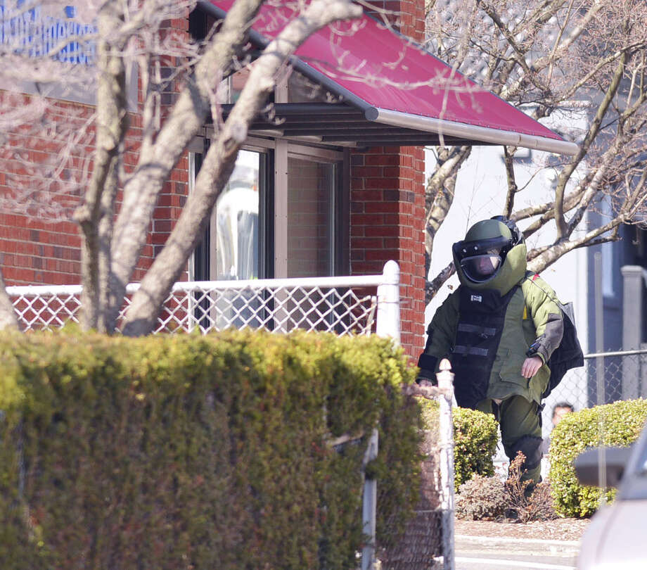 A Stamford bomb squad police officer at the scene of a reported suspicious package at the Bank of America branch located at 30 South Water St. in the Byram section of Greenwich, Wednesday, March 26, 2014. Photo: Bob Luckey / Greenwich Time