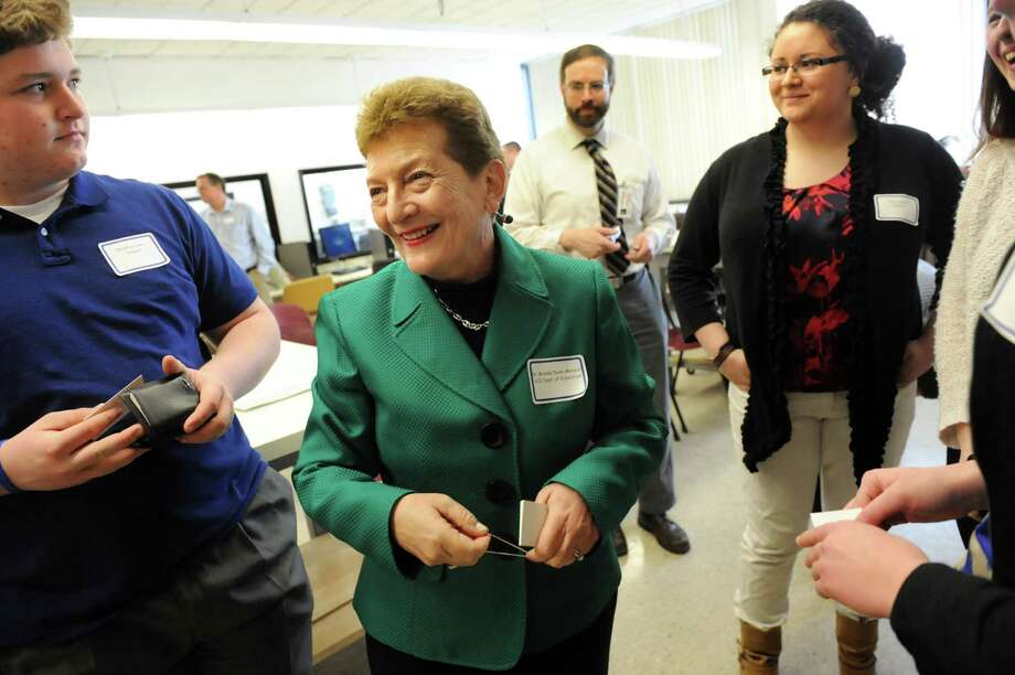 U.S. Under Secretary Brenda Dann-Messier, center, greets BOCES high school students in the Advanced Manufacturing program before their presentation on Wednesday, March 26, 2014, at SUNY Adirondack in Queensbury, N.Y. (Cindy Schultz / Times Union) Photo: Cindy Schultz / 00026237A