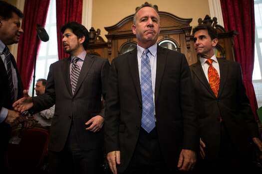 State Senate president pro tempore Darrell Steinberg, center, is flanked by Sen. Kevin de Leon, left, and Sen. Mark Leno, right, as they take questions from reporters regarding Sen. Leland Yee's indictment after a press conference in Steinberg's office at the State Capitol in Sacramento, California, March 26, 2014. Photo: Max Whittaker/Prime, Special To The Chronicle