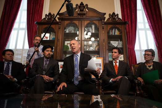State Senate president pro tempore Darrell Steinberg, center, calls on Sen. Leland Yee to resign during a press conference in his office at the State Capitol in Sacramento, California, March 26, 2014. Photo: Max Whittaker/Prime, Special To The Chronicle