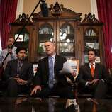 State Senate president pro tempore Darrell Steinberg, center, calls on Sen. Leland Yee to resign during a press conference in his office at the State Capitol in Sacramento, California, March 26, 2014.