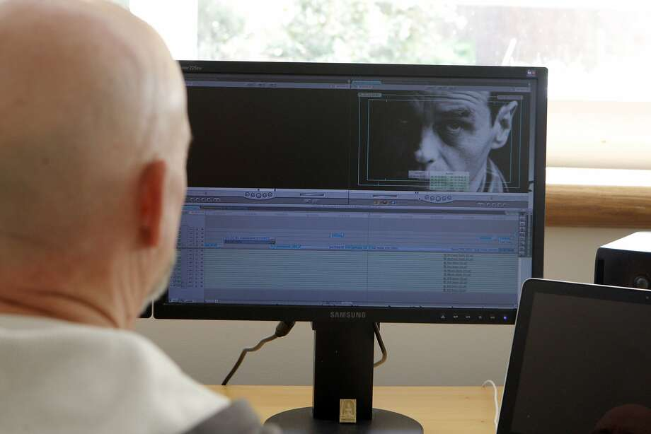 Bill Weber, who started as an editor of high-end commercials and music videos, edits a documentary in his Castro home. Photo: Jessica Olthof, The Chronicle