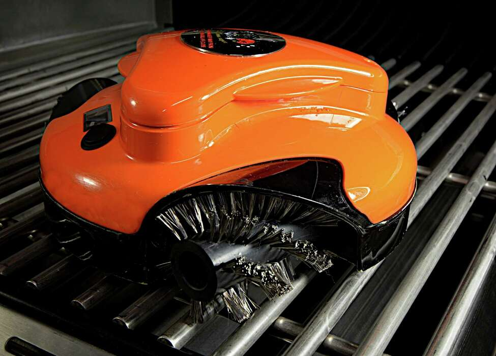 In an undated handout photo, the Grillbot. The bot, housing three rotary brass or stainless-steel brushes in heat-resistant plastic, is advertised as being able to clean any grill surface autonomously within 30 minutes. (Handout via The New York Times) -- NO SALES; FOR EDITORIAL USE ONLY WITH STORY SLUGGED CIR-ROBOT-SERVANTS BY HAMMILL AND HENDRICKS. ALL OTHER USE PROHIBITED. ORG XMIT: XNYT100