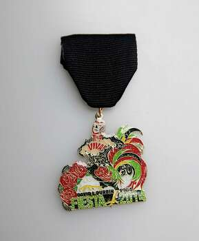 David L. Durbin's Fiesta medal marks his 50th birthday. Photo: Juanito M. Garza, San Antonio Express-News / San Antonio Express-News
