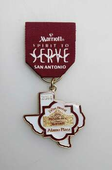 Residence Inn Marriott Fiesta medal is given to guests and is traded, www.marriott.com/hotels/travel/satrw-residence-inn-san-antonio-downtown-alamo-plaza. Photo: Juanito M. Garza, San Antonio Express-News / San Antonio Express-News