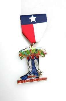 San Antonio Stock Show & Rodeo's Fiesta medal, $10, at the Fiesta Store and at sarodeo.com. Photo: JUANITO M GARZA, San Antonio Express-News / San Antonio Express-News