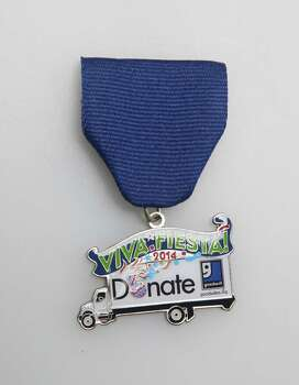 Goodwill Industries of San Antonio's Fiesta medal will be given away through social media sites, www.goodwillsa.org. Photo: Juanito M. Garza, San Antonio Express-News / San Antonio Express-News