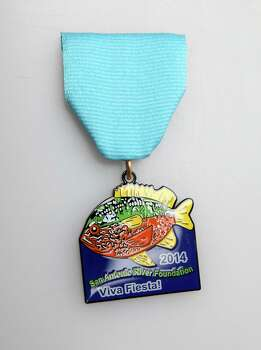 San Antonio River Foundation's 2014 Fiesta medal represents its most noted arts installation. The group is not selling its medal, www.sariverfoundation.org. Photo: Juanito M. Garza, San Antonio Express-News / San Antonio Express-News