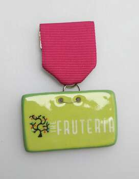 The Fruteria, Johnny Hernandez restaurant on South Flores, not for sale, the ceramic medal is handcrafted by artisans in Jalisco, Mexico, www.chefjohnnyhernandez.com/thefruteria. Photo: Juanito M. Garza, San Antonio Express-News / San Antonio Express-News
