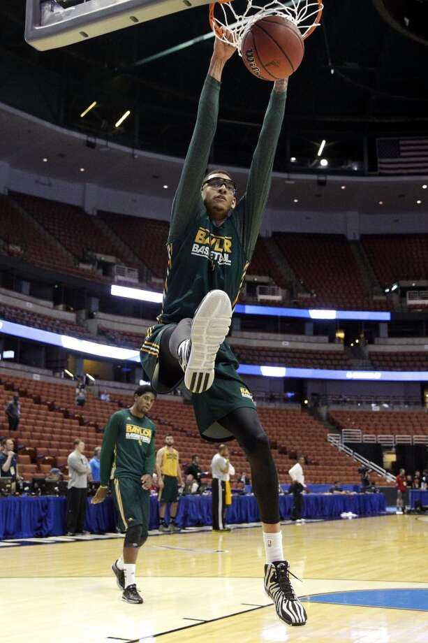 Baylor's Isaiah Austin dunks during practice at the NCAA college basketball tournament on Wednesday, March 26, 2014, in Anaheim, Calif. Baylor plays Wisconsin in a regional semifinal on Thursday. Photo: Jae C. Hong, Associated Press