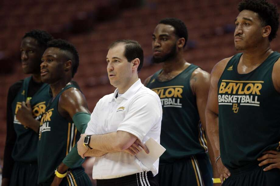 Baylor head coach Scott Drew, center, stands with Ish Wainright, from right, Rico Gathers, Gary Franklin and Taurean Prince during practice at the NCAA college basketball tournament on Wednesday, March 26, 2014, in Anaheim, Calif. Baylor plays Wisconsin in a regional semifinal on Thursday. Photo: Jae C. Hong, Associated Press