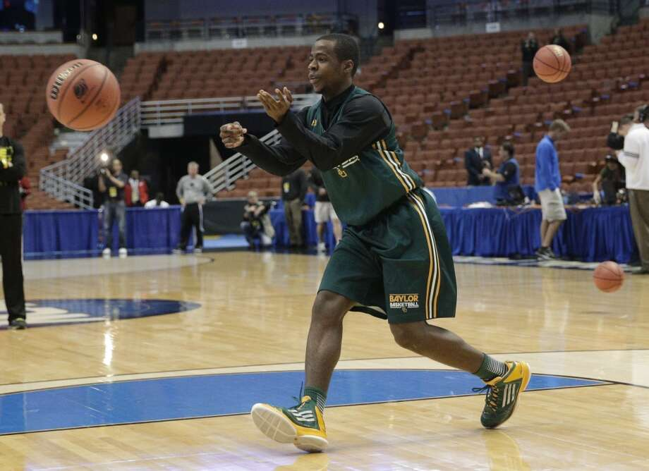 Baylor's Kenny Chery passes the ball during practice at the NCAA college basketball tournament Wednesday, March 26, 2014, in Anaheim, Calif. Baylor plays Wisconsin in a regional semifinal on Thursday. Photo: Jae C. Hong, Associated Press