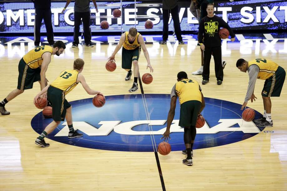 Baylor players dribble during practice at the NCAA college basketball tournament on Wednesday, March 26, 2014, in Anaheim, Calif. Baylor plays Wisconsin in a regional semifinal on Thursday. Photo: Jae C. Hong, Associated Press