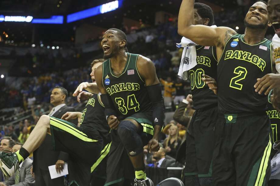Bear starters show their excitement at the end of the game as Baylor beats Creighton 85-55 in the third round of the 2014 NCAA Divison I  Men's Basketball Championship tournament  at the AT&T Center on March 23, 2014. Photo: Tom Reel, San Antonio Express-News