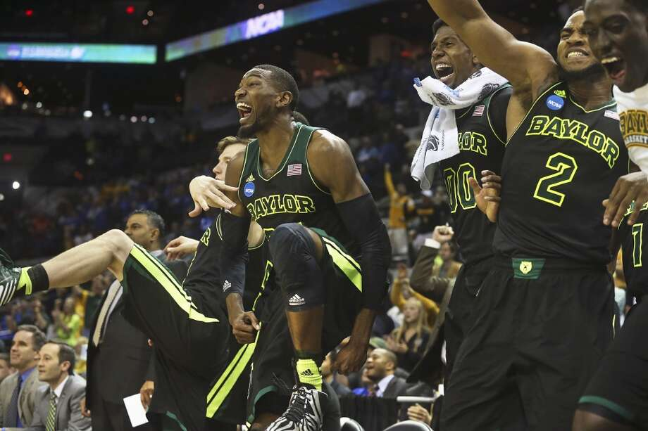 The Bears celebrate in the final moments in their victory as Baylor beats Creighton in the third round of the 2014 NCAA Divison I  Men's Basketball Championship tournament  at the AT&T Center on March 23, 2014. Photo: Tom Reel, San Antonio Express-News