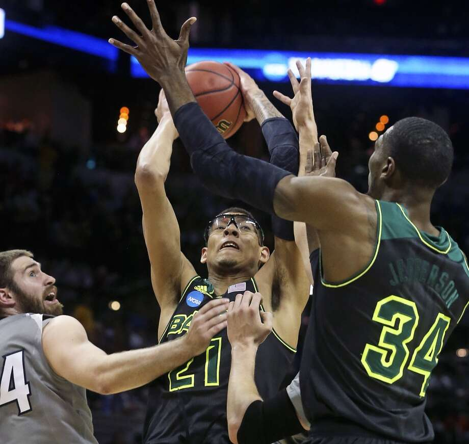 Isaiah Austin pulls down a defensive rebound in the first half as Baylor plays Creighton in the third round of the 2014 NCAA Divison I  Men's Basketball Championship tournament  at the AT&T Center on March 23, 2014. Photo: Tom Reel, San Antonio Express-News