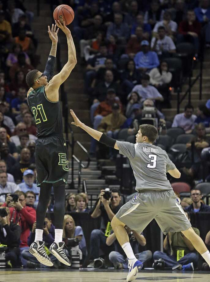 Isaiah Austin gets a shot over Doug McDermott in the first half as Baylor plays Creighton in the third round of the 2014 NCAA Divison I  Men's Basketball Championship tournament  at the AT&T Center on March 23, 2014. Photo: Tom Reel, San Antonio Express-News