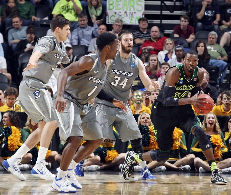 Baylor's Cory Jefferson (34) looks for room around Creighton's Doug McDermott (03) Creighton's Austin Chatman (01), and Creighton's Ethan Wragge (34) during second half action of their third round 2014 NCAA Division I Men's Basketball Championship tournament game held Sunday March 23, 2014 at the AT&T Center. Baylor won 85-55. Photo: Edward A. Ornelas, San Antonio Express-News