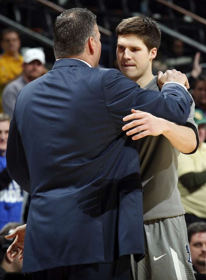 Creighton head coach Greg McDermott hugs his son Creighton's Doug McDermott (03) late in their third round 2014 NCAA Division I Men's Basketball Championship tournament game against Baylor Sunday March 23, 2014 at the AT&T Center. Baylor won 85-55. Photo: Edward A. Ornelas, San Antonio Express-News