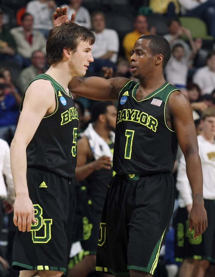 Baylor's Brady Heslip (05) is congratulated by teammate Baylor's Kenny Chery (01) after making a 3-pointer during second half action of their third round 2014 NCAA Division I Men's Basketball Championship tournament game against Creighton held Sunday March 23, 2014 at the AT&T Center. Baylor won 85-55. Photo: Edward A. Ornelas, San Antonio Express-News