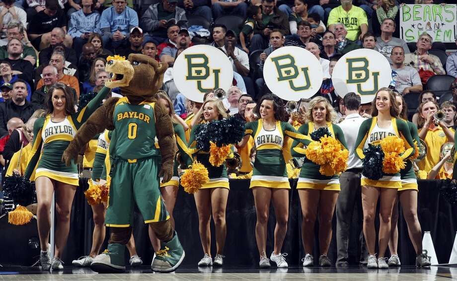 Members of the Baylor cheerleaders perform during the  first half in the third round 2014 NCAA Division I Men's Basketball Championship tournament game with Creighton held Sunday March 23, 2014 at the AT&T Center. Photo: Edward A. Ornelas, San Antonio Express-News