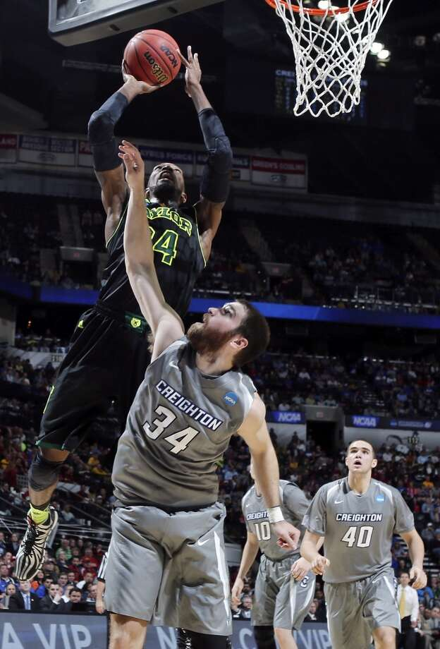 Baylor's Cory Jefferson (34) shoots over Creighton's Ethan Wragge (34) during first half action of their third round 2014 NCAA Division I Men's Basketball Championship tournament game held Sunday March 23, 2014 at the AT&T Center. Photo: Edward A. Ornelas, San Antonio Express-News