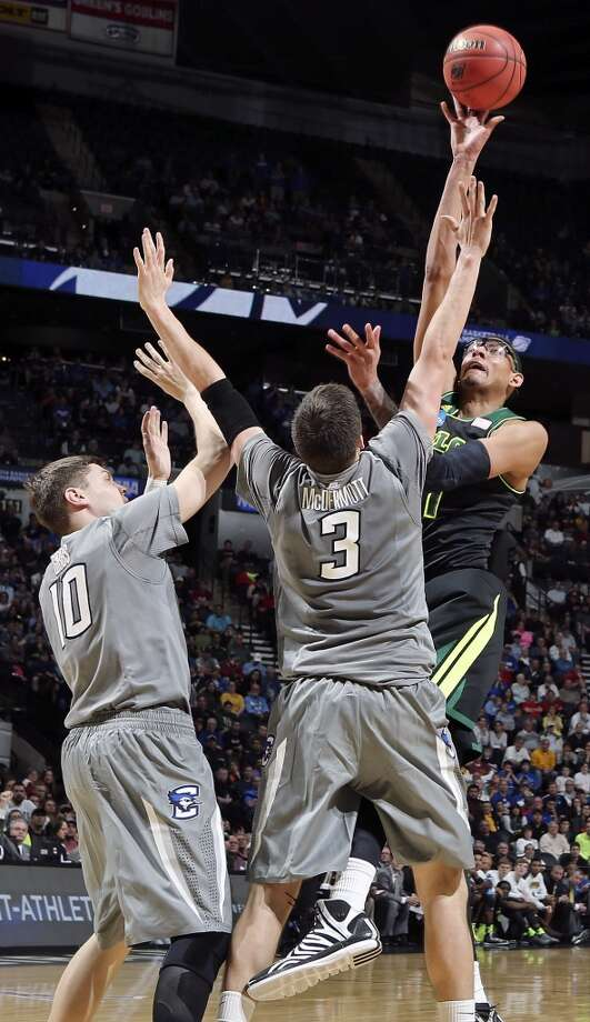 Baylor's Isaiah Austin (21) shoots over Creighton's Grant Gibbs (10) and Creighton's Doug McDermott (03) during first half action of their third round 2014 NCAA Division I Men's Basketball Championship tournament game held Sunday March 23, 2014 at the AT&T Center. Photo: Edward A. Ornelas, San Antonio Express-News